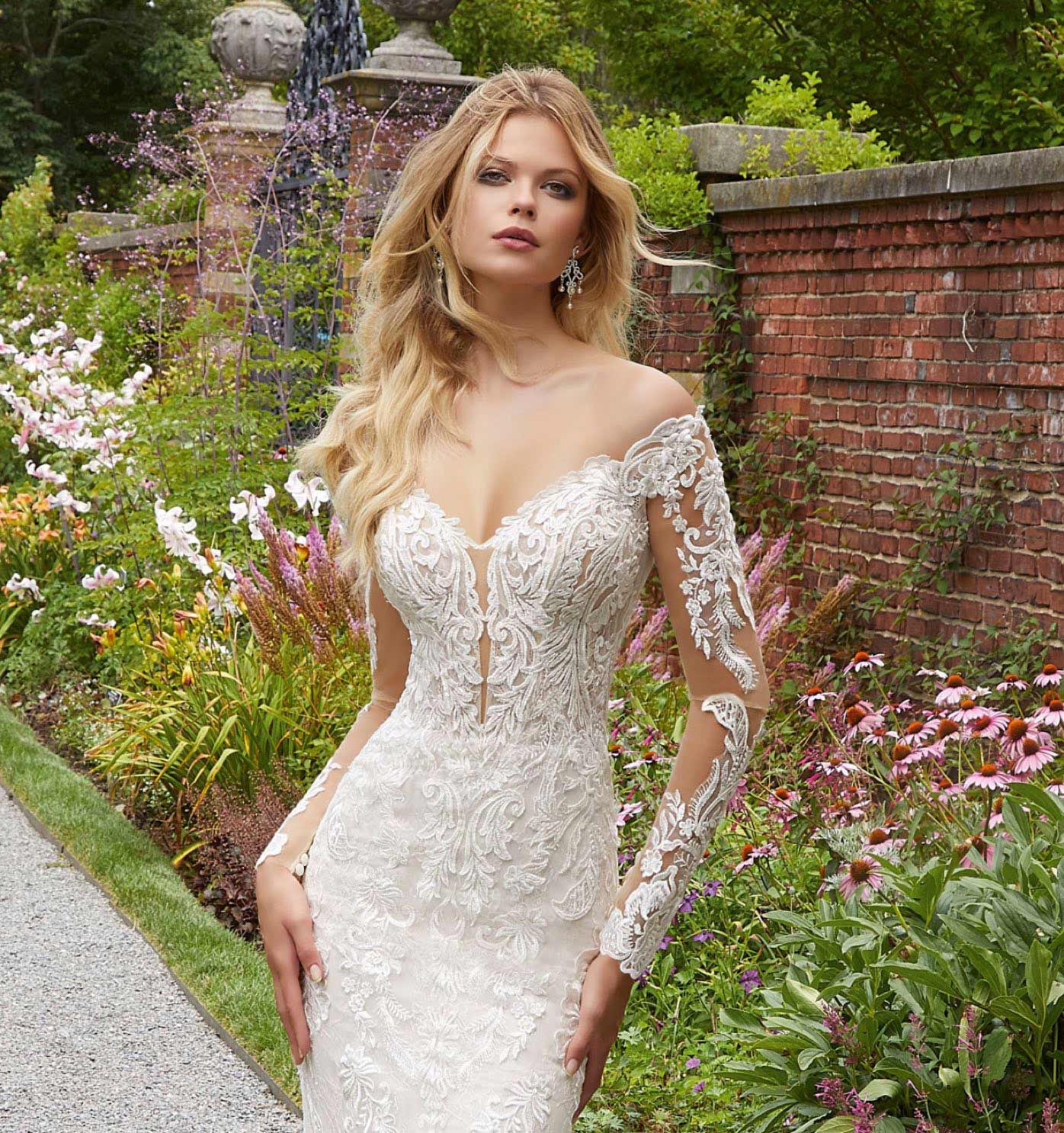 Model in wedding dress with sleeves