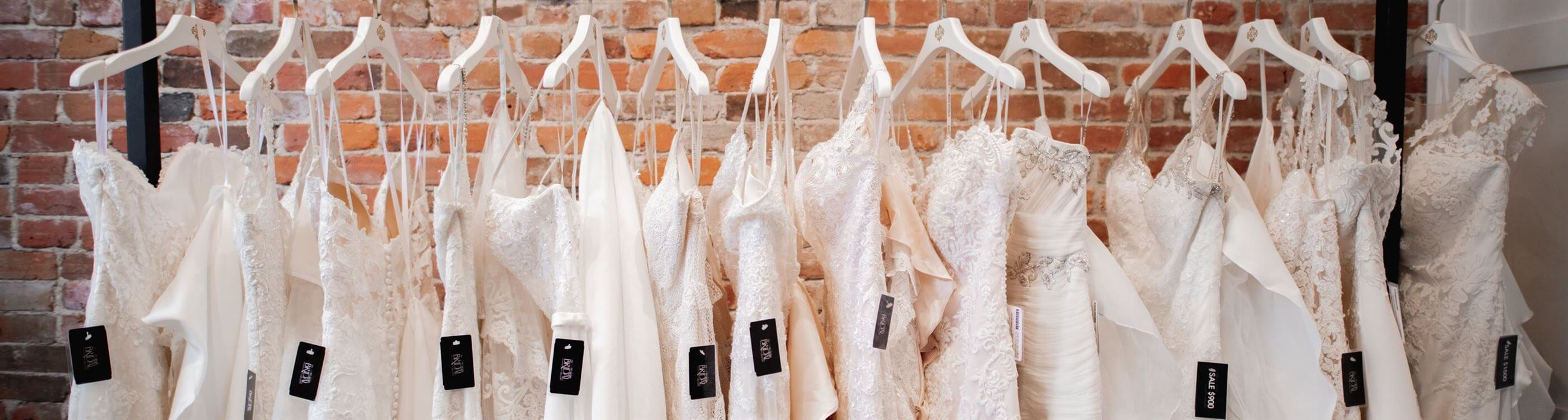 Wedding dresses on racks