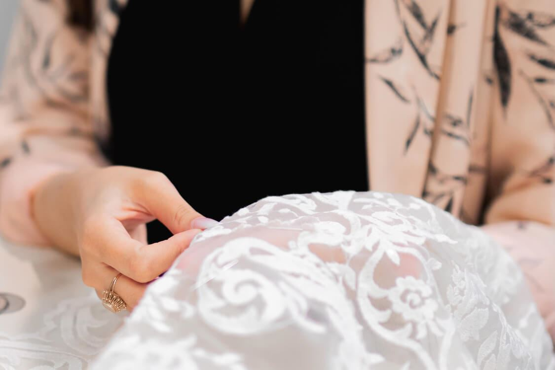 seamstress sewing wedding gown